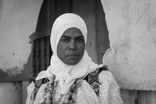 A Grayscale Photo of a Woman Wearing Hijab