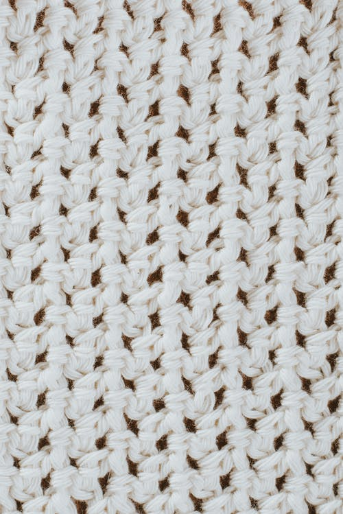 From above texture of knitted wool fabric with seamless pattern as abstract background