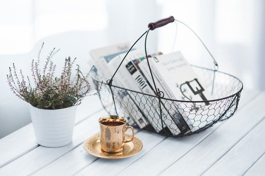 Golden cup and basket with books
