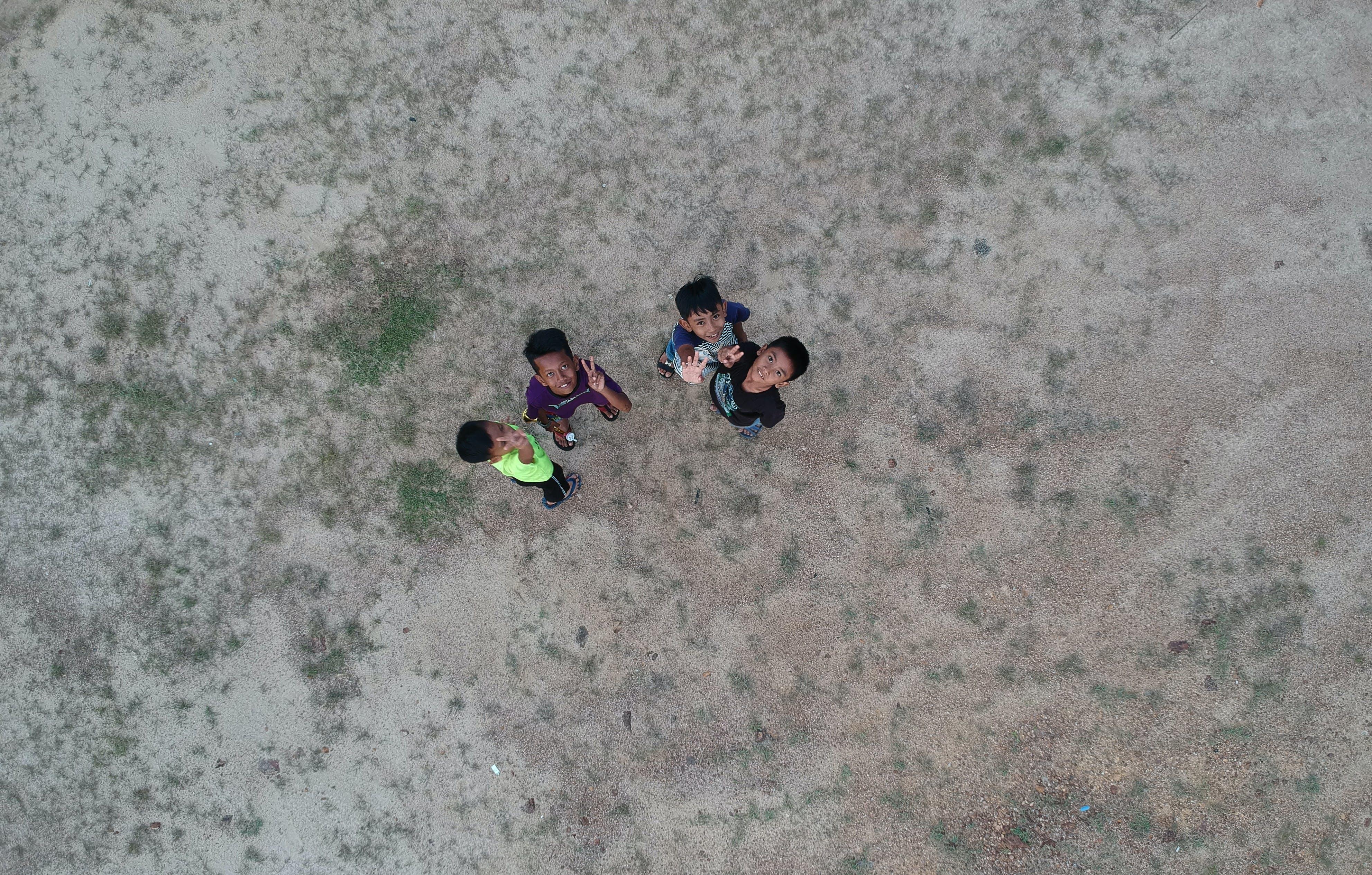 Kids Waving to Sky