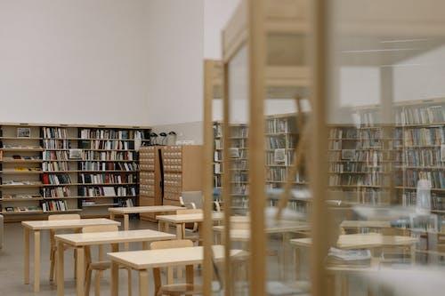 Brown Wooden Book Shelf Near White Wall