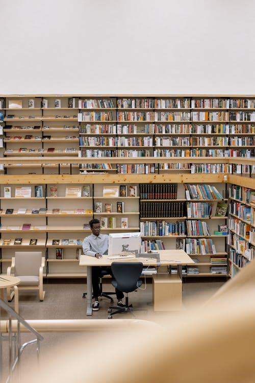 Man Using Computer In Library