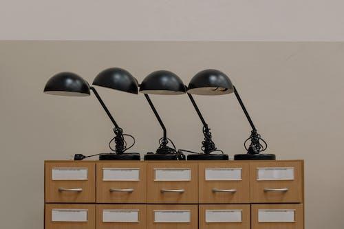 Black Headphones on Brown Wooden Cabinet