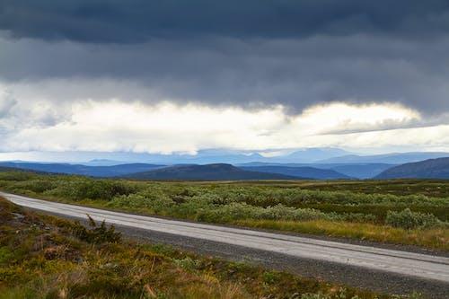 Free stock photo of cloud, grass, mountain
