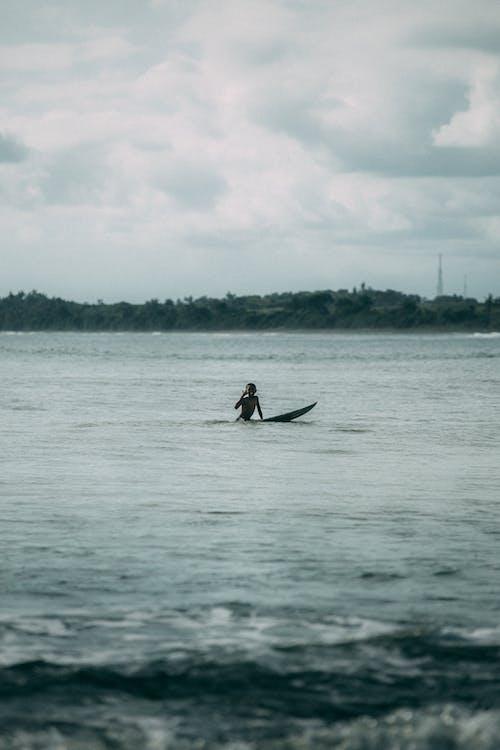 Man Riding on Boat on Sea