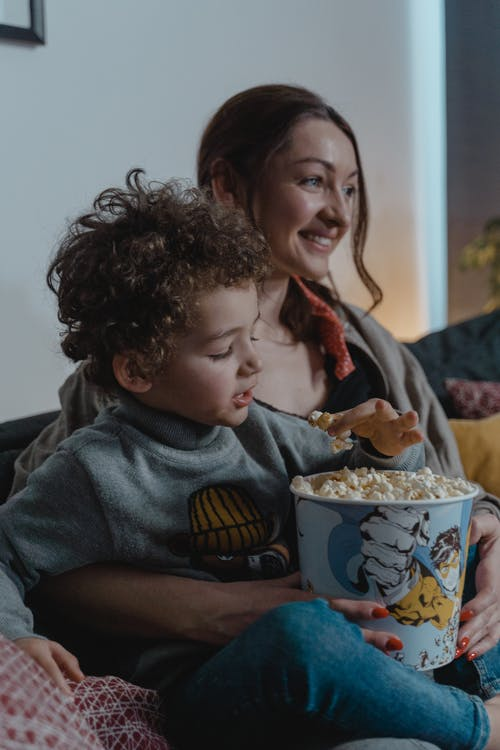 Mother and Son Eating Popcorn
