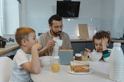Father Eating Breakfast with Children