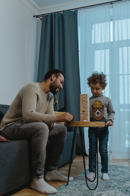 Woman in Gray Sweater Sitting Beside Boy in Gray Sweater