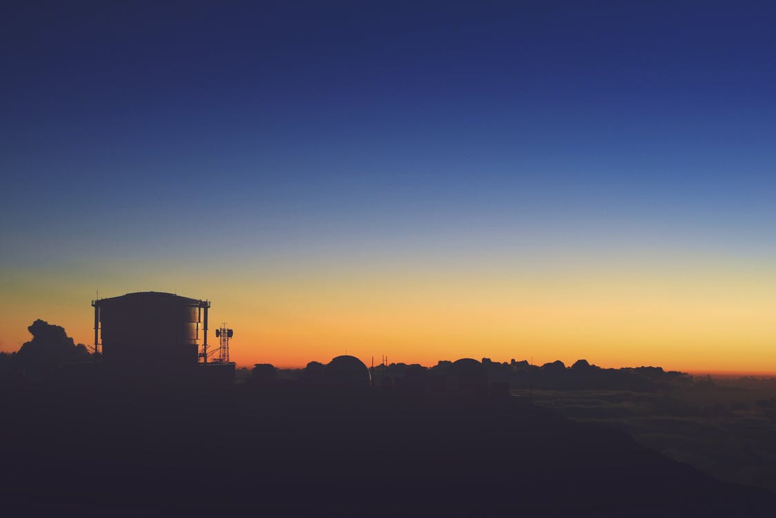 Silhouette of House After Sunset