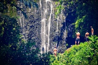 Group of People At A Waterfall