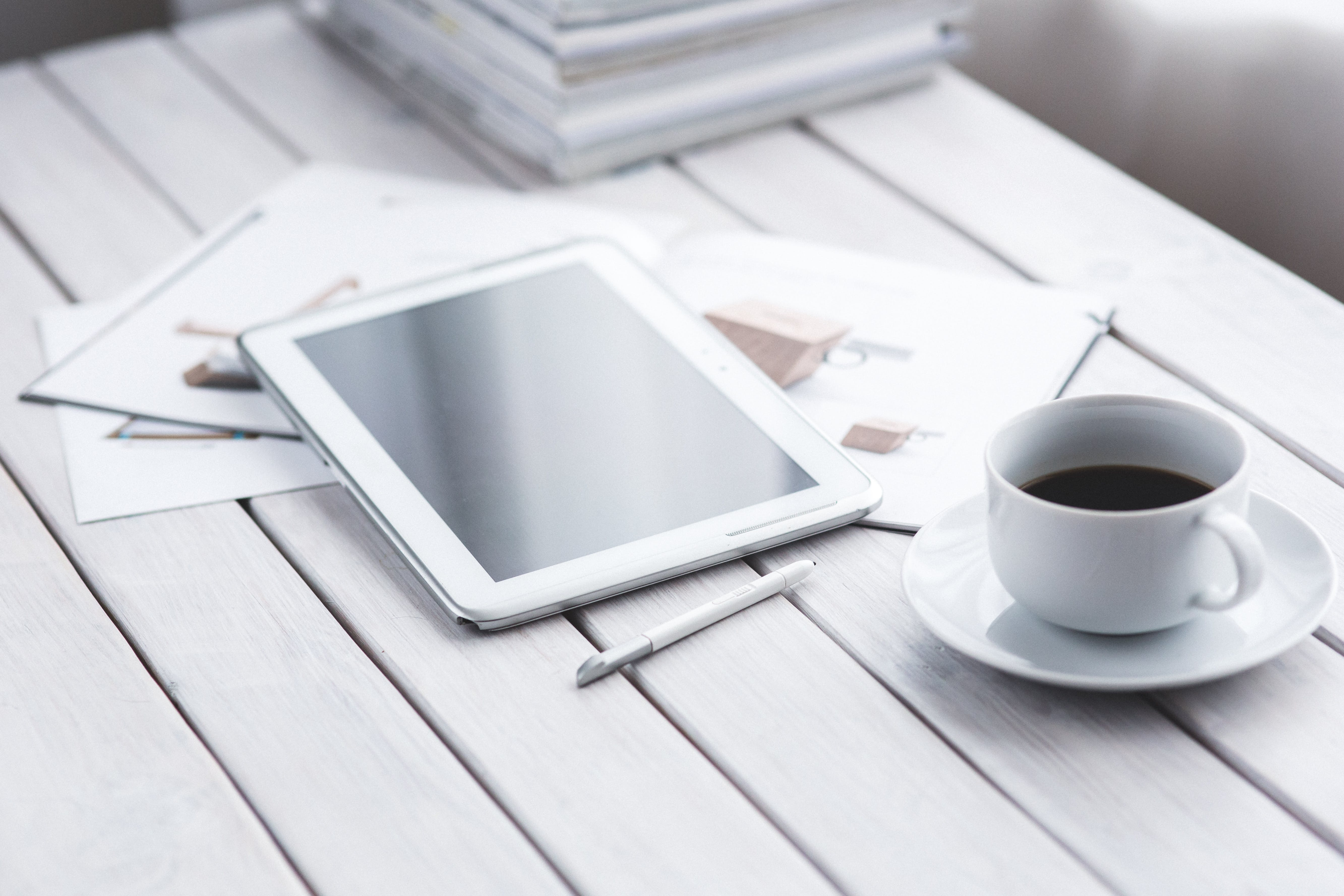 White tablet and cup of coffee