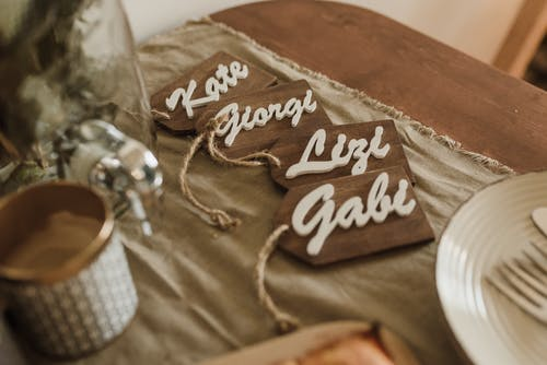 Wooden name tags arranged on table during wedding ceremony