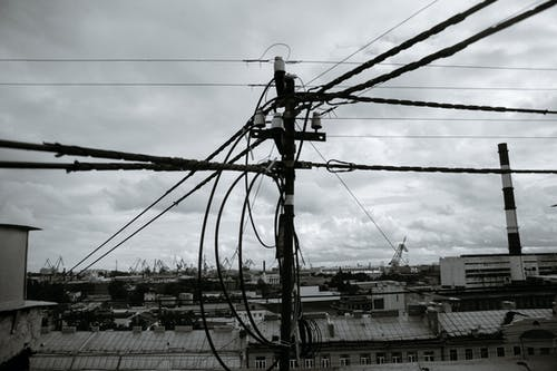 Grayscale Photo of a Power Line