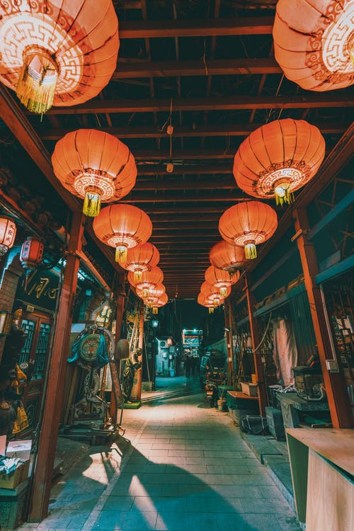 Low-Angle Shot of Chinese Lanterns Hanging on the Ceiling