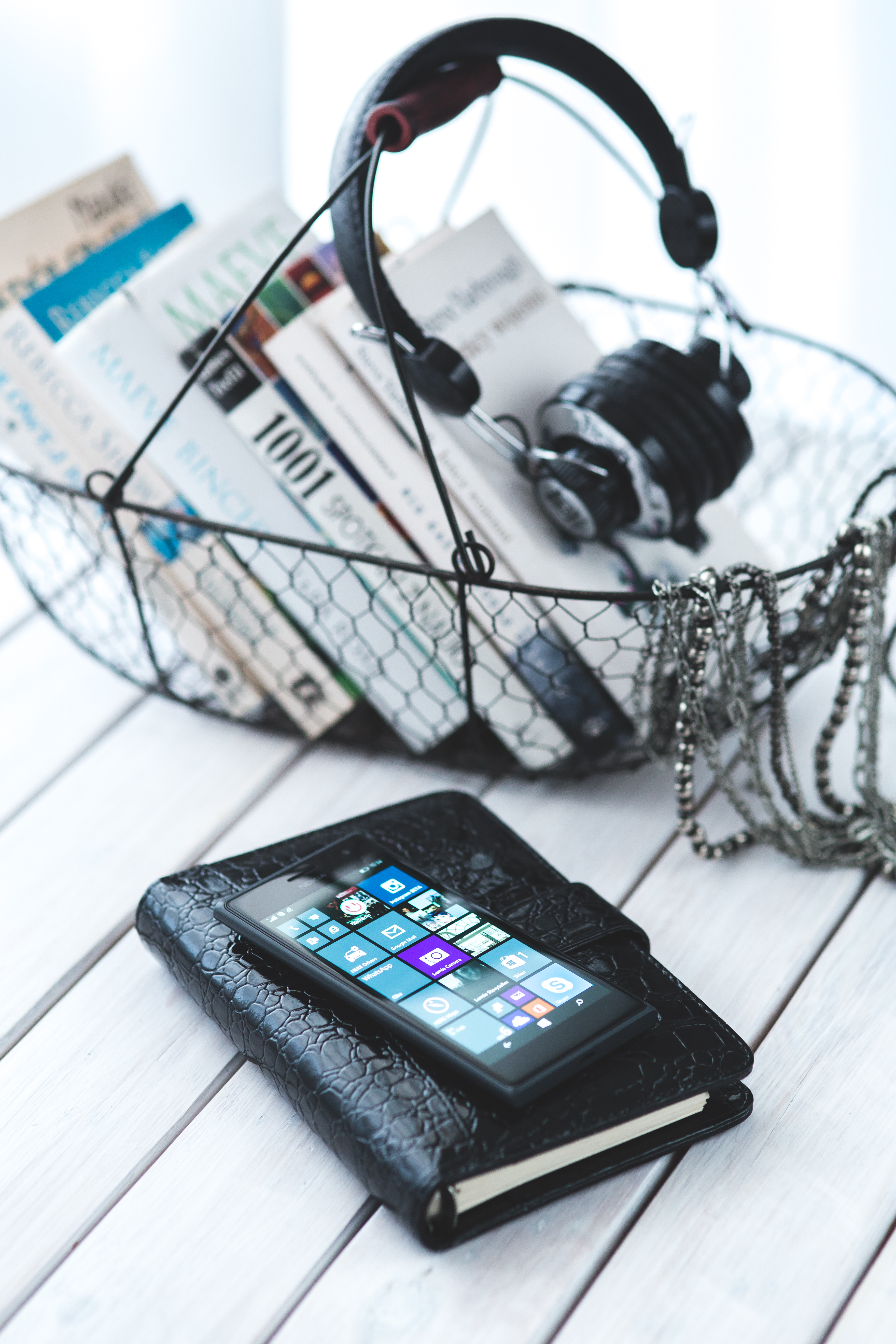 Mobile phone on a elegant black notebook