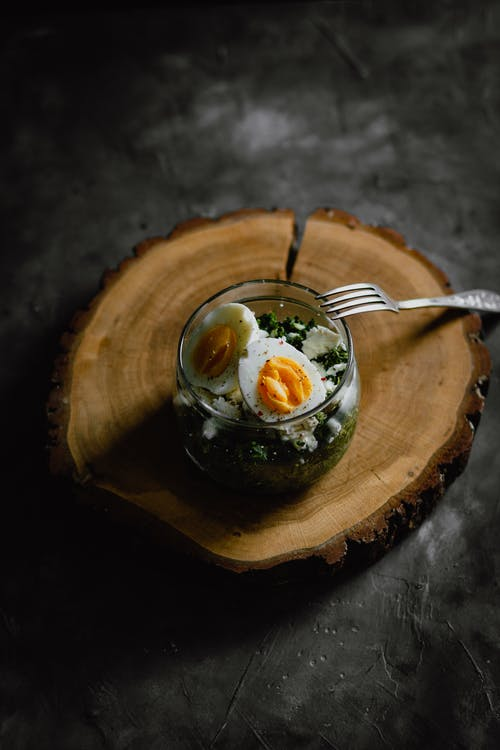 Delicious breakfast with boiled eggs and salad in jar
