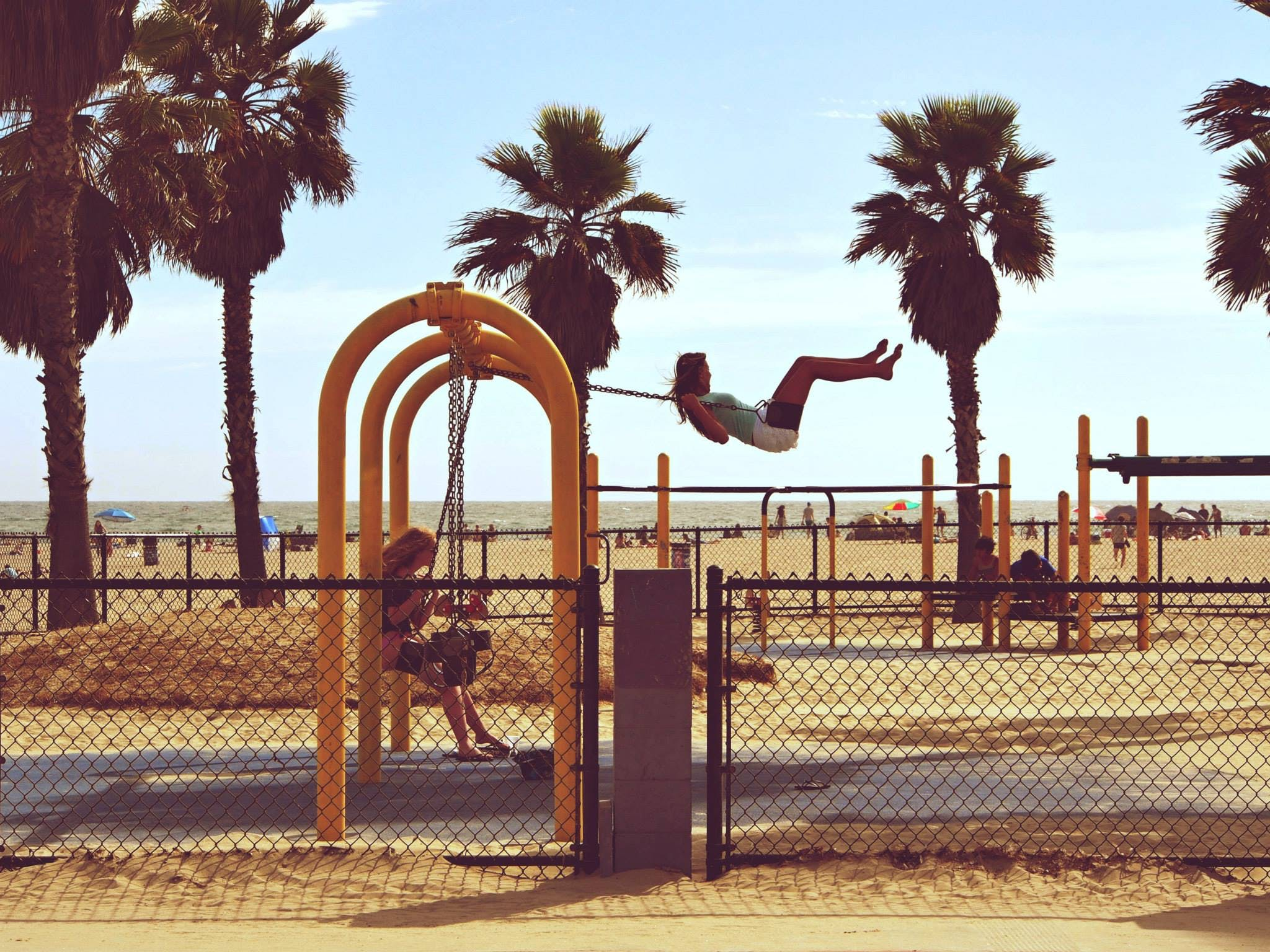 Woman Playing Swing Near Beach