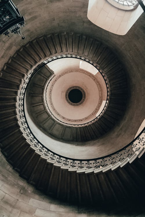 Brown Spiral Staircase With White Ceiling