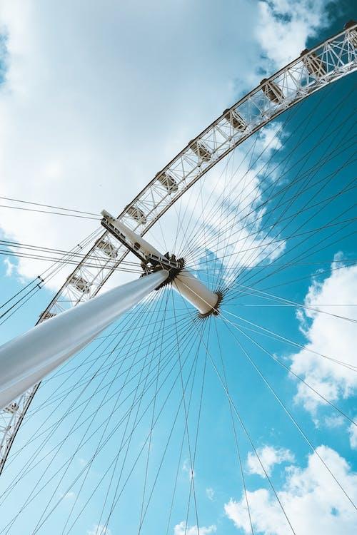 White and Black Ferris Wheel Under Blue Sky