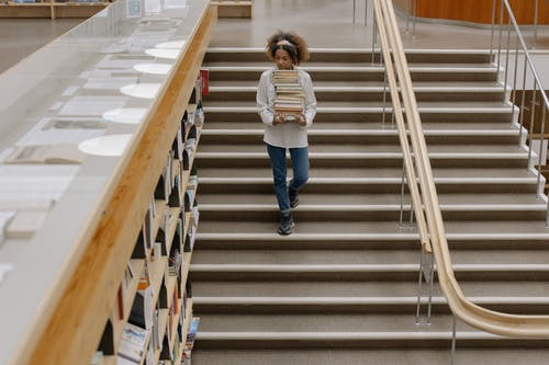 Photo Of Woman Walking Down The Stairs