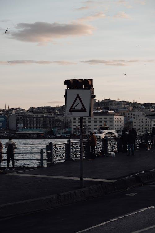 People standing on pavement of bridge