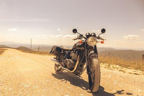 Black Cruiser Motorcycle on Brown Field
