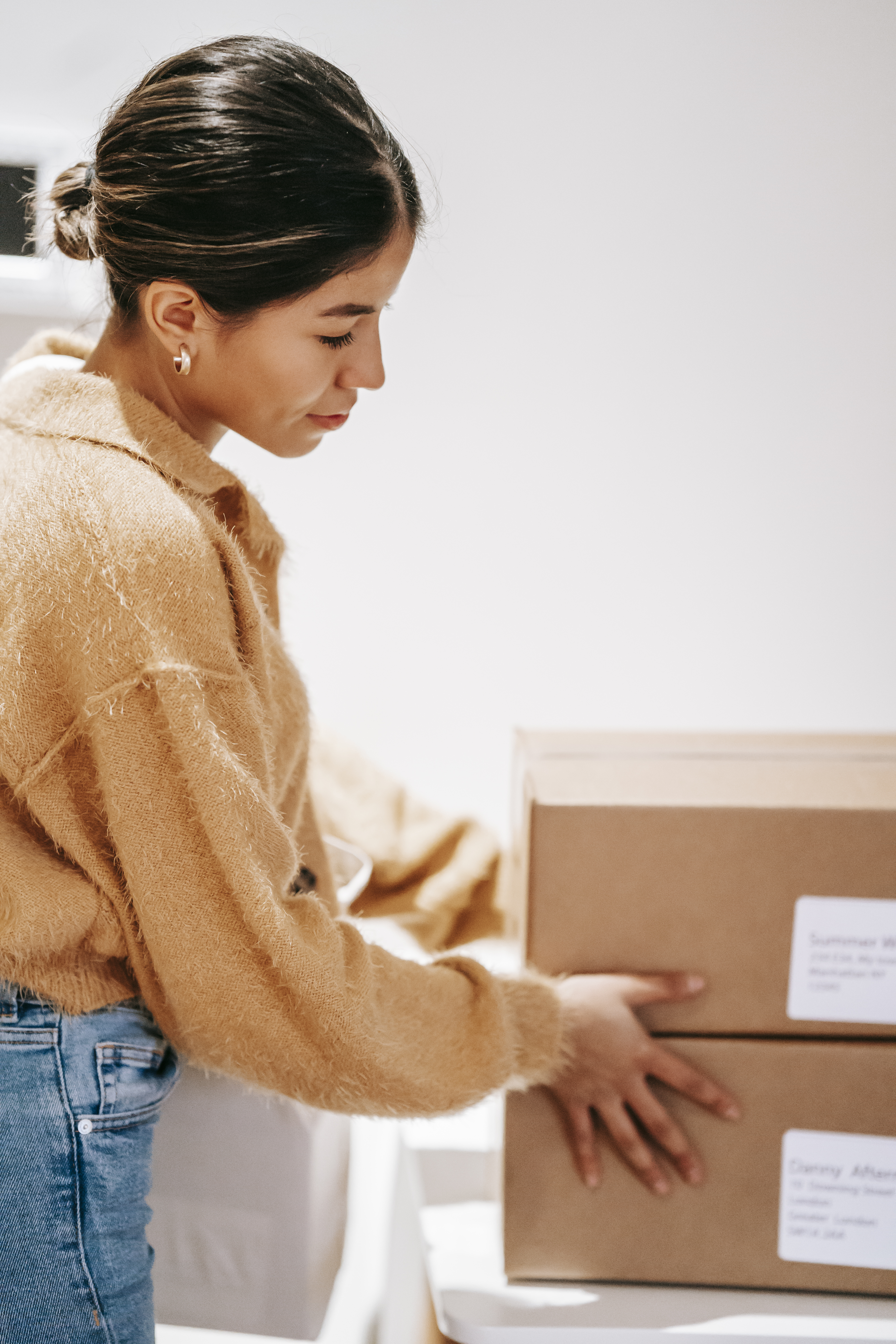 young woman with delivered carton boxes