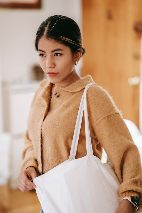 Young ethnic woman with cloth shopping bag