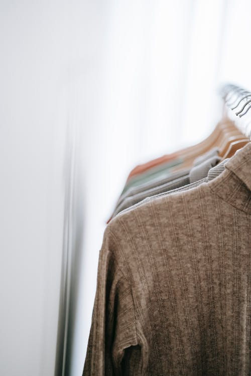 Room interior with clothes on hangers