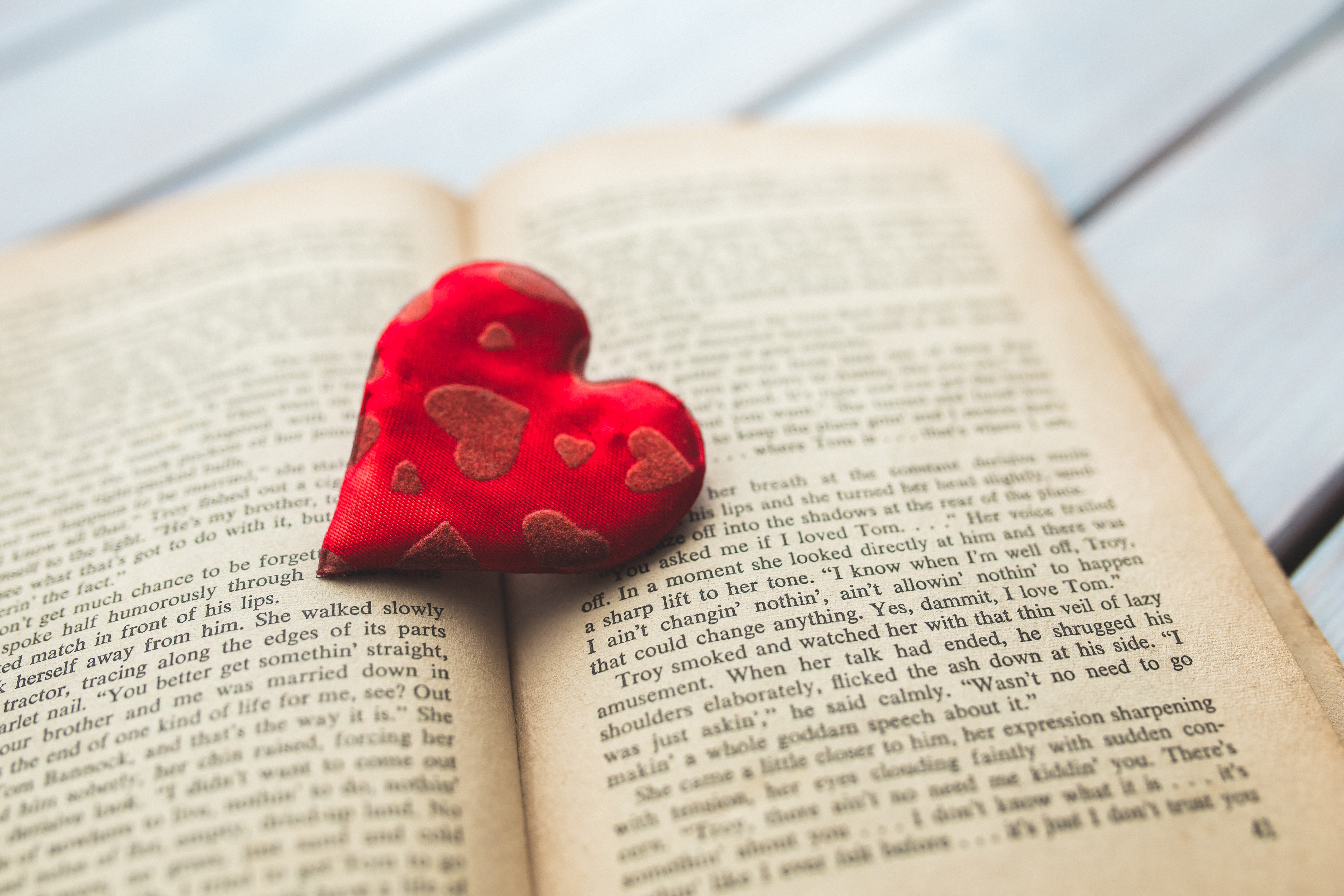 Red heart on a old opened book · Free Stock Photo