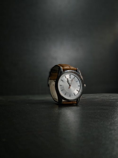 An Analog Wristwatch With Brown Leather Strap