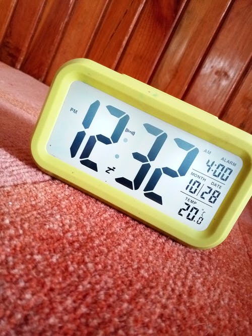 Close-Up Photography of Yellow Alarm Clock