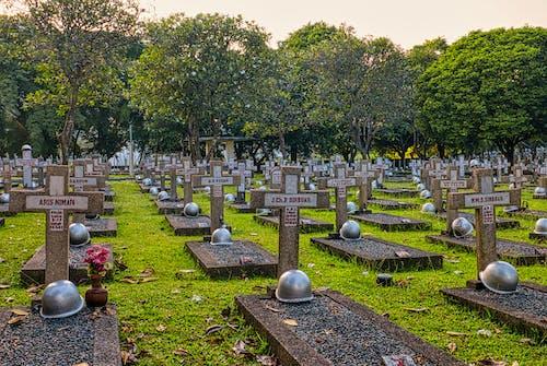 Gravestones with crosses on cemetery