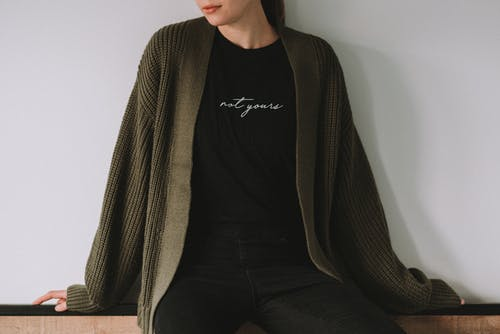 Crop gentle woman with Not Yours inscription on outfit
