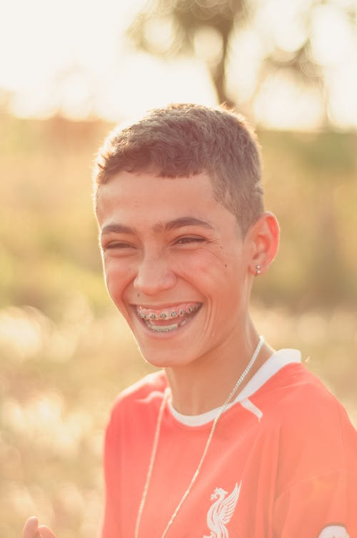 Laughing boy with braces looking away