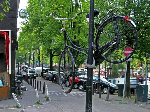 A Bicycle Chained to a Metal Post