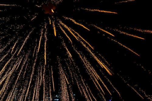 Glowing sparks illuminating dark sky