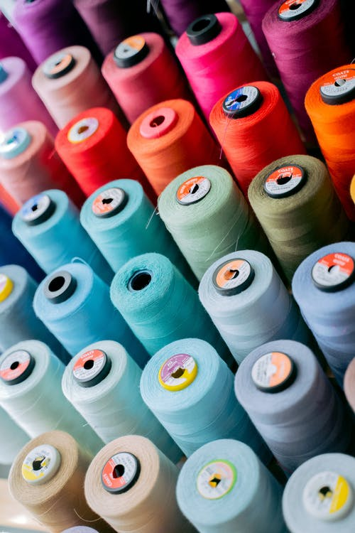 White Green and Red Thread Rolls