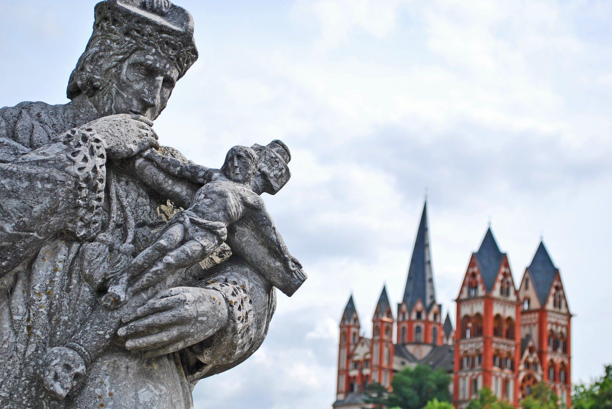 Man Holding Man on Cross Gray Statue