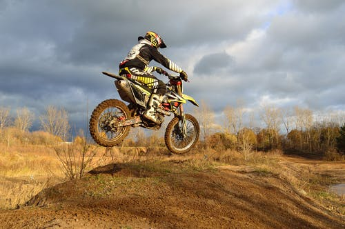 Motocross Rider on His Dirt Bike during Daytime