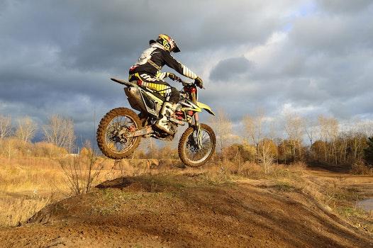 Motocross Rider on His Dirt Bike during Daytime