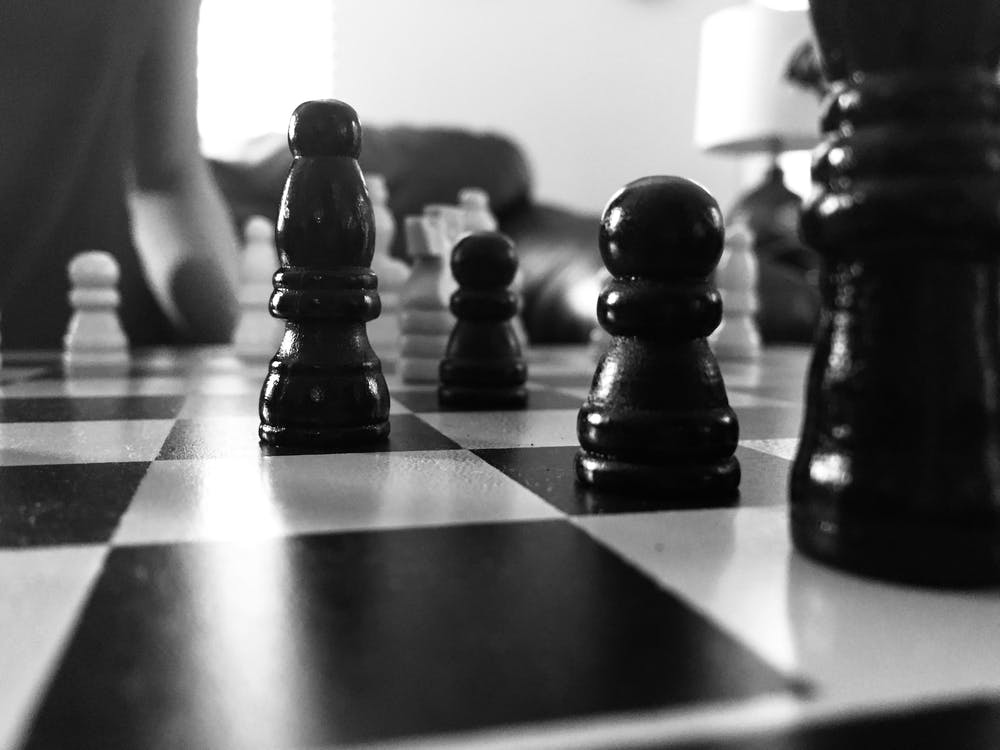 Grayscale Photography Of Chess Board