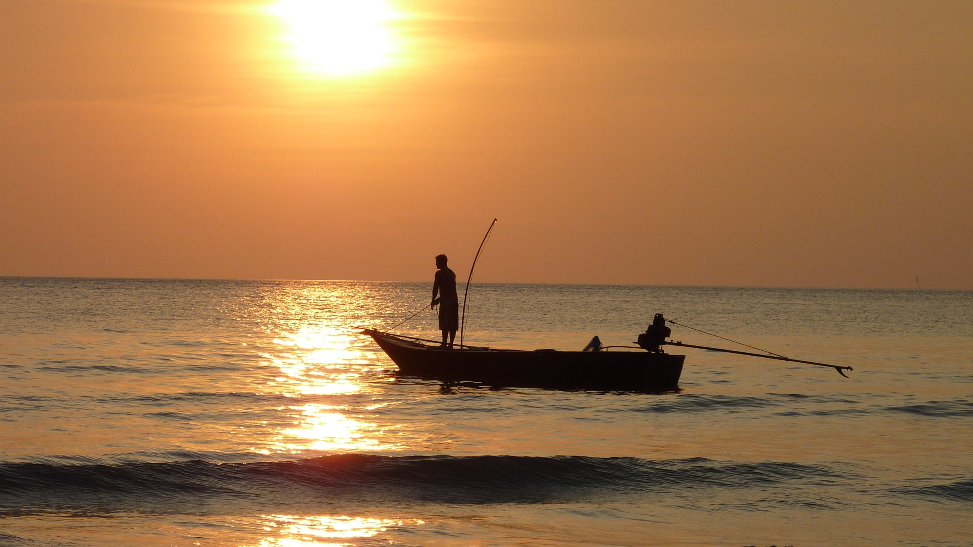 Silhouette Photography of Two Fishermen on Boat during Sunset