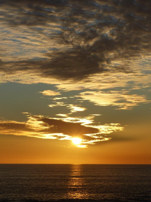 Amazing sunset sky over waving sea