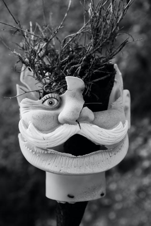 White Bird Ceramic Figurine in Grayscale Photography