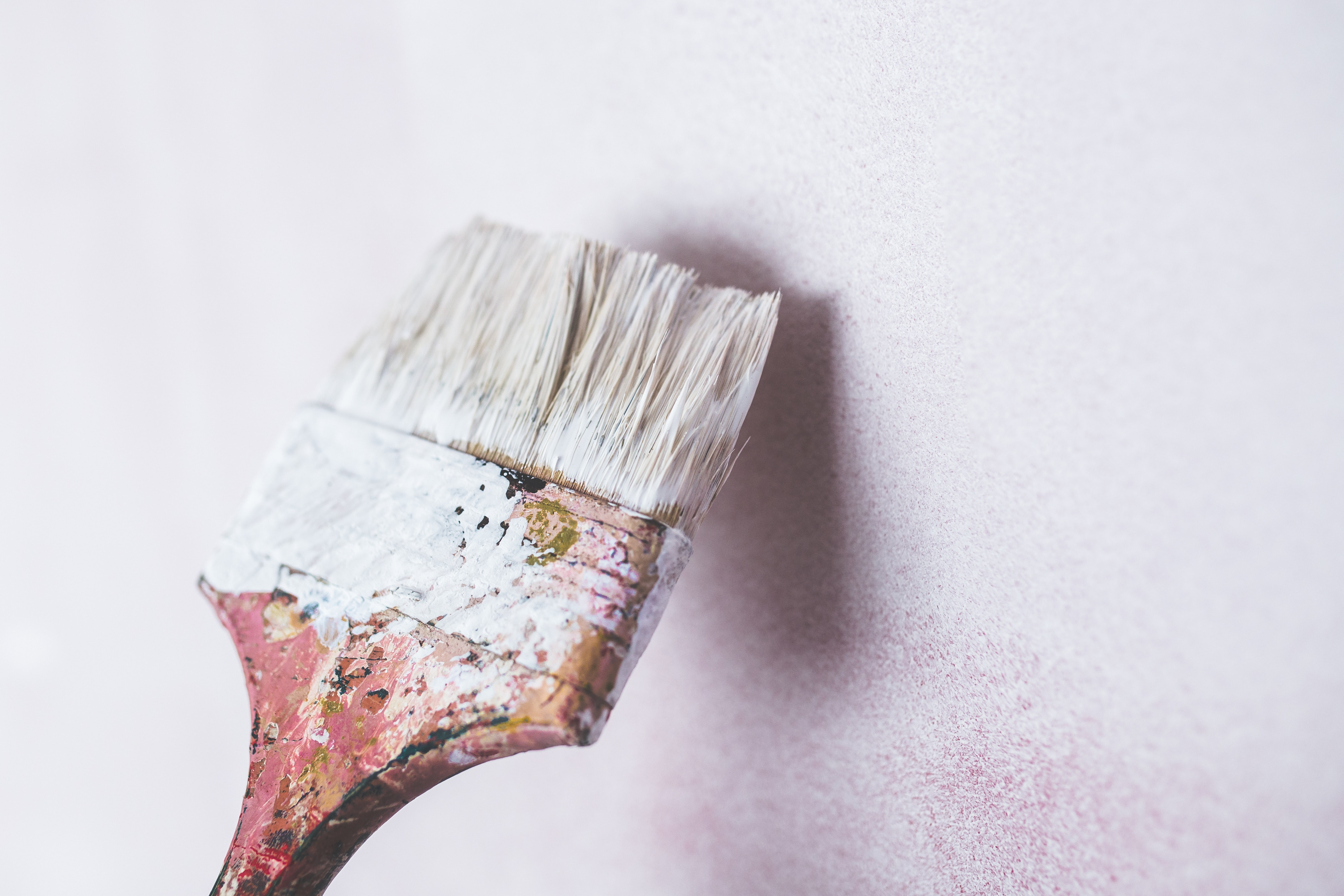 Brush Painting The White Wall Free Stock Photo