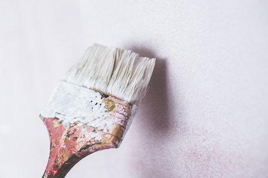 Brush painting the white wall