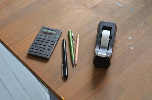 Stationary on brown office table