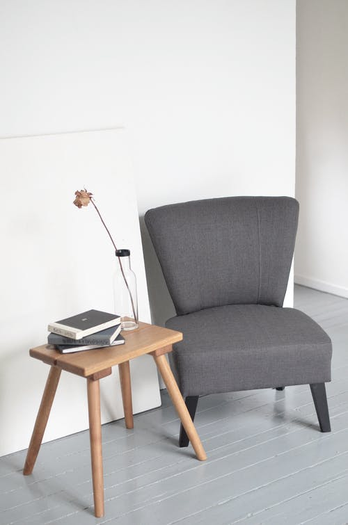 Interior details of minimalist office with comfortable armchair and small table