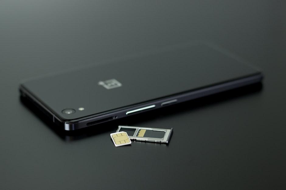 Black Smartphone on Black Table Top